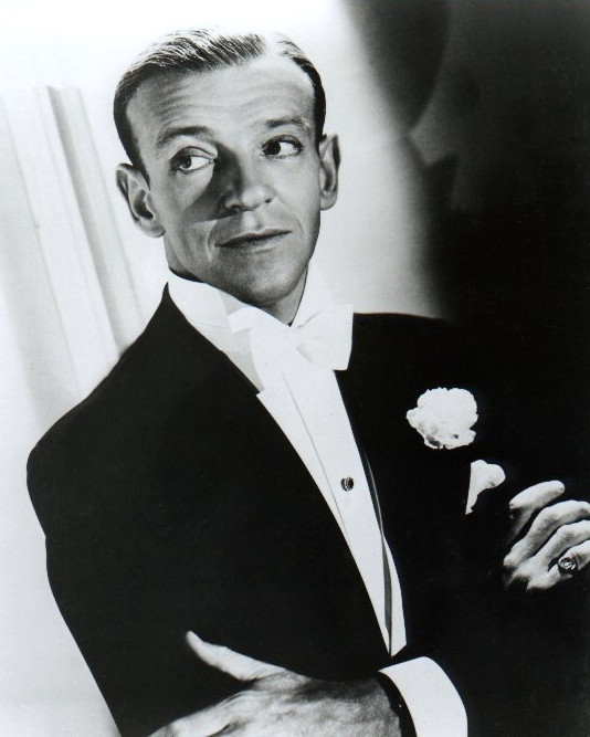 Fred Astaire dons a classic white carnation boutonniere.